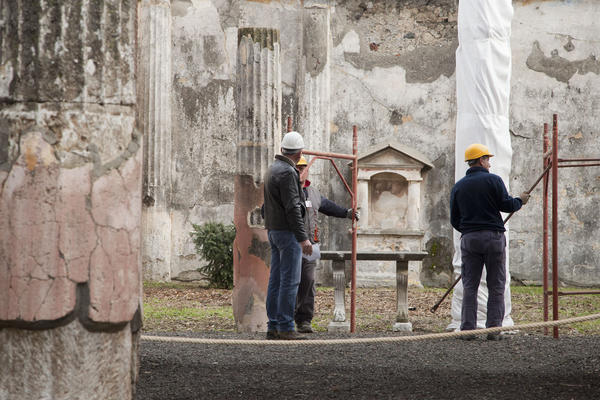 Restoration crews work on a building at the ancient Roman city of Pompeii.