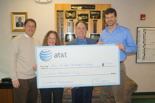 From left at the recent presentation of a $5,000 donation from AT&T to the ARC of the Farmington Valley are state Sen. Kevin Witkos (R-8), FAVARH Development Director Ronelle Cipolla, AT&T Director of External and Legislative Affairs Kinson Perry and FAVARH Executive Director Stephen Morris.