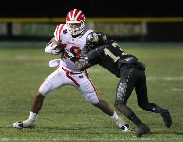Mater Dei wide receiver Thomas Duarte runs past Narbonne cornerback Bruce Hicks in a game Sept. 28, 2012.