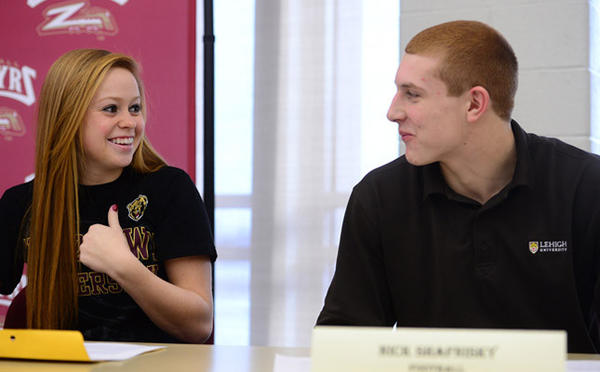 Nick Shafnisky smiles at Cassie Schmidt during letter of intent ceremony. Schmidt will play soccer at Kutztown and Shafnisky will play football at Lehigh. Whitehall High School had nine students sign letters of intent Wednesday.