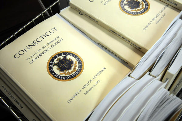 The Governor's new budget awaits distribution in room 2C of the LOB Wednesday morning prior to the noon budget address in the House by Governor Malloy.