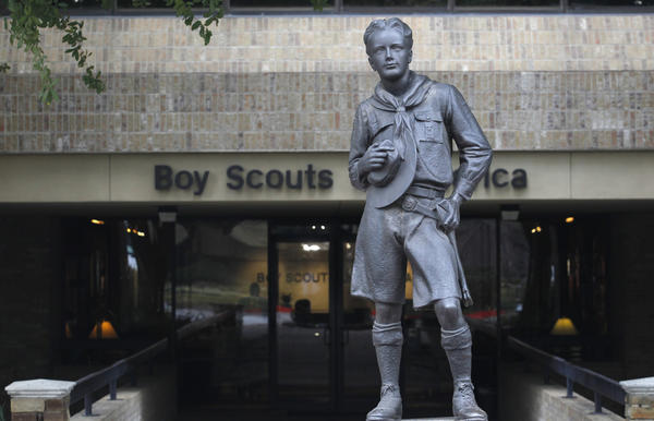 The statue of a scout stands in the entrance to Boy Scouts of America headquarters in Irving, Tex. The Scouts announced they would delay a decision about whether to lift the ban on openly gay members until May to further study the matter.