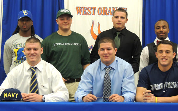 West Orange athletes on National Signing Day: Starting bottom left, Nate Ozdemir (Naval Academy), Winston Chastang (Naval Academy), Juan Fajardo (North Florida), back row: Roman Tate (Delaware), Gary Gotling (Stetson), Brad Brown (Stetson), Drakkar Harris (Edward Waters)