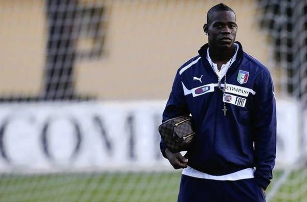 Mario Balotelli looks on at the end of a training session at Coverciano training center.