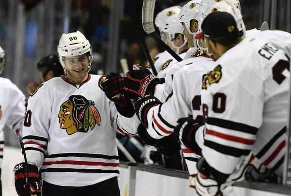 Brandon Saad is congratulated by his Blackhawks teammates scoring his first NHL goal in the first period against the Sharks at HP Pavilion.