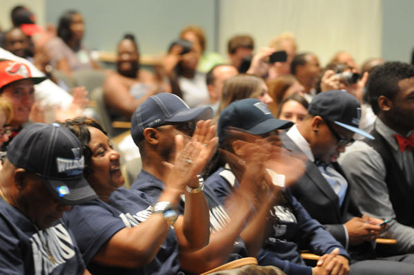 Families and fellow University School football players cheer after Jordan Cunningham announced he was signing with Vanderbilt University during National Signing Day at University School Wednesday morning in Davie.  Cunningham was surrounded by his family and coaches as his announcement was televised on ESPN.