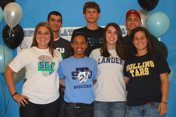 Hagerty High School athletes on National Signing Day: Front Row: Jacey Castro (Softball - Manatee State College), Amyah Banks (Soccer - St. Thomas University), Allison Capps (Soccer - Lander College), Samantha Collins (Soccer - Rollins College). Back Row: Michael Savs (Basketball - Florida Gulf Coast University), Stephen Jackson (Basketball - Lake Sumter State College), Brandon Mentlick (Football- Minot State University).