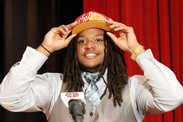 Defensive lineman Anthony Lawson selects Tuskegee University during a National Signing Day assembly at Northeast High School in Ft. Lauderdale on Wednesday, Feb. 6, 2013.