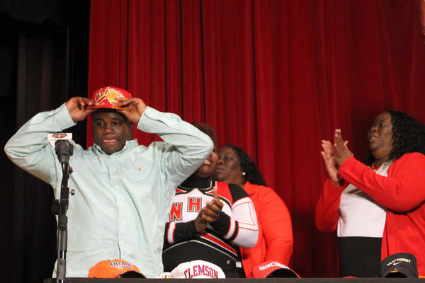 Running back/linebacker Timonte King selects Tuskegee University during a National Signing Day assembly at Northeast High School in Ft. Lauderdale on Wednesday, Feb. 6, 2013.