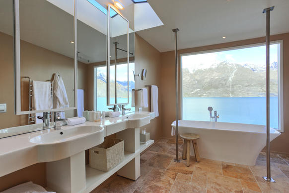 "Perched on the edge of Lake Wakatipu and blessed with one of the most iconic, ""Lord of the Rings""-style panoramas in the country, Matakauri is close to Queenstown, the adventure capital of the world, but far enough away to be blissfully private. Six deluxe suites, sequestered in native forest, have oversized tubs with picture windows facing the lake's turquoise glacial waters and the snow-capped Remarkables mountains."