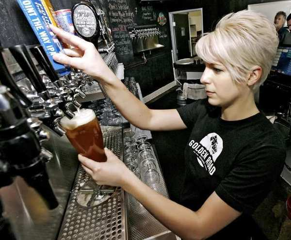 Bartender Sara Hildebrandt serves up a beer at Golden Road Brewing in Glendale.