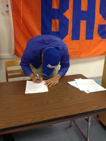 Bloomfield's David Campbell signs his letter to attend Central Connecticut State.