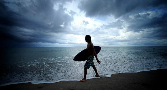 A skimboarder prepares to hit the water off Boca Raton.