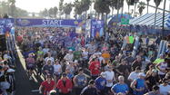 A course record was set in the 17th annual Surf City USA Marathon on Sunday.