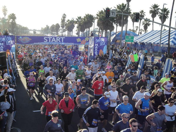 The Surf City marathon and half-marathon had more than 21,000 runners and a crowd of more than 50,000 lining the streets to cheer them on Sunday.