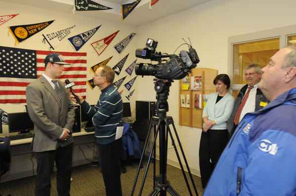 Peter Gerson is interviewed by FOX-CT at the signing ceremony at Hand High School in Madison Wednesday morning.