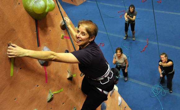 Stephanie Gibson, 58, of Baltimore, climbing. On the ground, clockwise from lower left, Kathy Feroli, Joan Hellman, and Carol Dix.