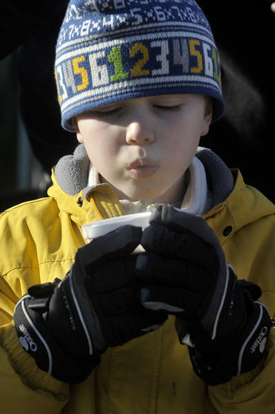 Colin Madaus of New London adds a cup of steaming hot chocolate to his winter wardrobe to endure the cold weather.