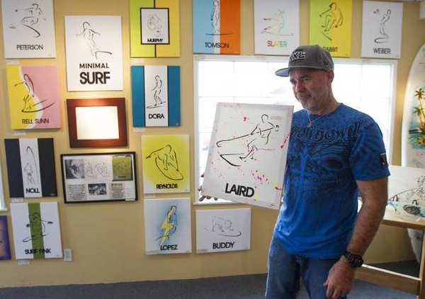 "Dave Reynolds with his ""Minimal Surf"" art show at the International Surfing Museum."