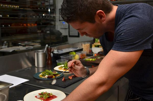 Michael Haycock puts the finishing touches on salmon crudo.