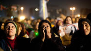 Mobs encircled and attacked dozens of women protesting in Cairo's Tahrir Square in a spate of sexual assaults last month, Amnesty International said in a new report released Wednesday, urging Egyptian President Mohamed Morsi to make sure the attackers were brought to justice.