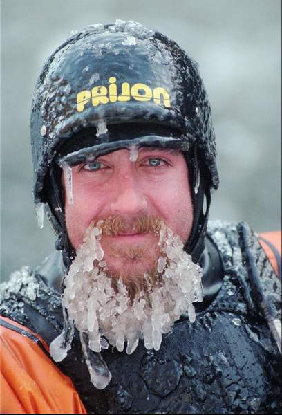 Ken Hill, covered with ice in the sub-freezing temperatures, smiles during a break from kayaking at the Tariffville Gorge on the Farmington River in East Granby, Conn.