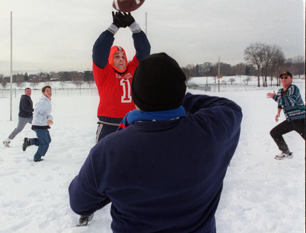 Greg Habzda, of Glastonbury, center left, goes up to block a pass by Jim O'Connell Sr., of Middletown (back to camera) during the Central Connecticut Association of Football Officials unofficial answer to the Super Bowl played at Colt Park in Hartford.
