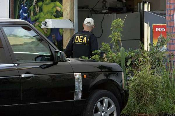 Marijuana's federal classification as a Schedule I drug prevents its use as physician-prescribed medicine. Above, DEA agents raid a Culver City medical marijuana dispensary in 2010.