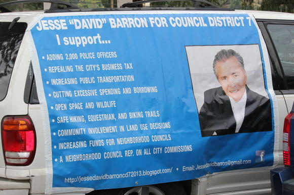 Jesse David Barron displays his campaign platform on his van.
