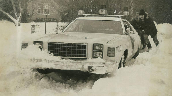 A police car stuck in the snow gets some help from a few Old Saybrook residents.