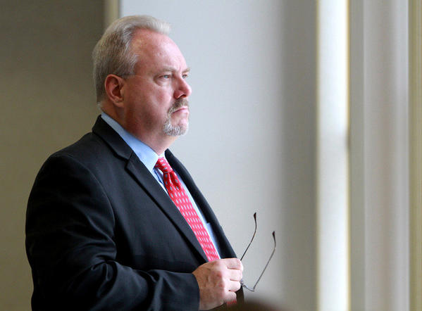 Jim Greer, the former chairman of the Republican Party of Florida, waits for his hearing to start at the Orange County Courthouse, in Orlando,  Friday, August 5, 2011.