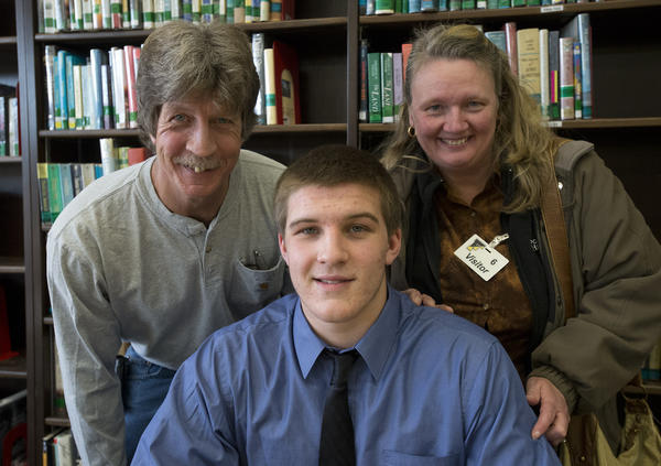 Paul and Debbie Peerson of Bethlehem Township are with son - Freedom High School Tyler Peerson, 17, after the senior participated in a mock contract signing for Lehigh University during National Signing Day on Wednesday.
