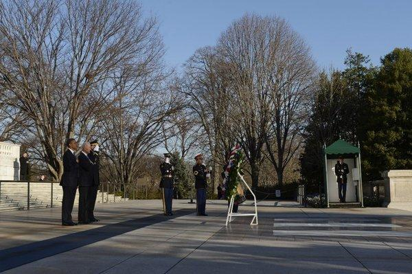 President Obama and Vice President Joe Biden participate in a wreath-laying ceremony at the Tomb of the Unknown Soldier in Arlington National Cemetery. Sen. Lisa Murkowski has introduced a bill to open national cemeteries to Hmong soldiers who helped the U.S. fight in the CIA-backed secret war in Laos.