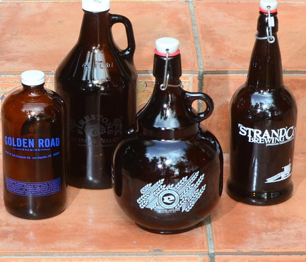 Growlers from assorted Southland breweries. In California, the law requires that a brewery only fill a growler printed with its own name and address.
