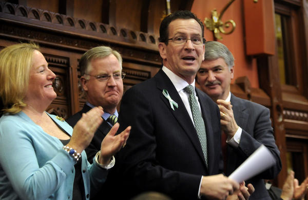 Gov. Dannel P. Malloy receives applause at the conclusion of his budget address Wednesday to a joint session of the General Assembly. With him are his wife, Cathy Malloy, House Speaker Brendan Sharkey and Senate President Pro Tem Donald Williams Jr.
