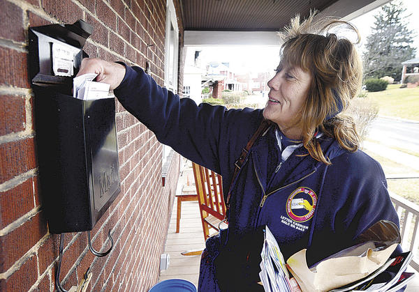 Mail carrier Patti Butler makes deliveries on Wednesday in the 700 block of Guilford Avenue in Hagerstown.