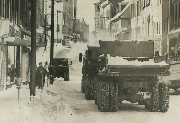 The Connecticut National Guard line up in downtown Norwich as part of a snow removal operation.