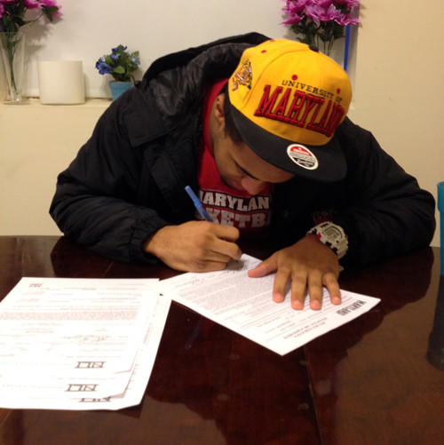 Catonsville's DeAndre' Lane signs his national letter of intent to play football at Maryland.