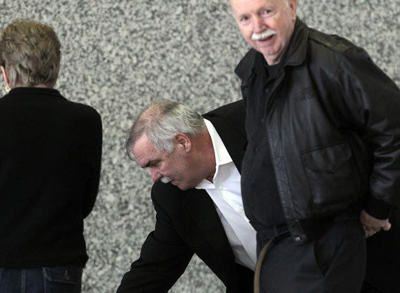 Former Chicago police officer Glenn Lewellen (middle) arrives at the Dirksen U.S. Courthouse for his trial today.
