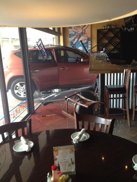 An elderly driver and a bartender escaped serious injury when an SUV crash through the front of a Sunrise restaurant
