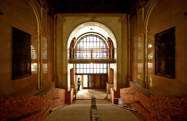 The terrazzo floors and historic iron-and-brass stairs are covered in the Hall of Justice's open lobby, or loggia. The building has been closed since the 1994 Northridge earthquake and is undergoing a complete renovation and retrofit.