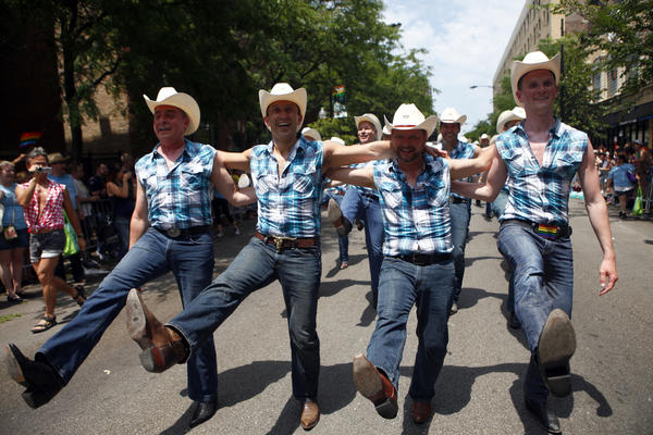 The Windy City Cowboys kick during the Pride Parade on Chicago's North Side in 2012. Pride Fest and Pride Parade this year will be held on separate weekends.