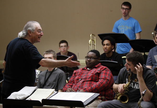 Justin DiCioccio, a jazz educator from Manhattan School of Music, works with students in the band.