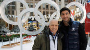 They installed the first outdoor Olympic rings Wednesday in Sochi, Russia, a 60-by-30-foot reminder that Thursday marks a year to go before the opening of the 2014 Winter Games.