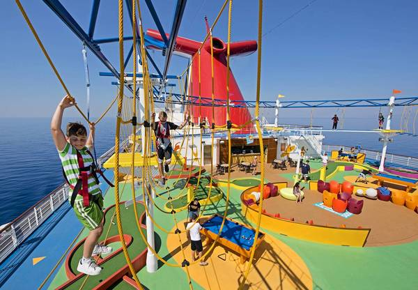 Youngsters on board the Carnival Breeze try out SkyCourse, a ropes' course at sea in which participants can traverse suspended cables with views 150 feet to the sea below. The course is part of an expansive outdoor recreation area on the ship called SportSquare.