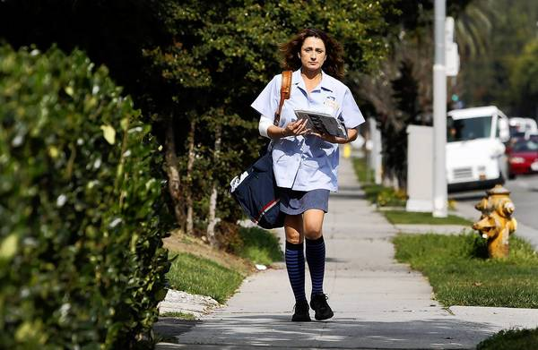 Miriam Cervantes delivers mail in Los Angeles. The American Postal Workers Union has joined those condemning plans to end Saturday delivery of most mail.