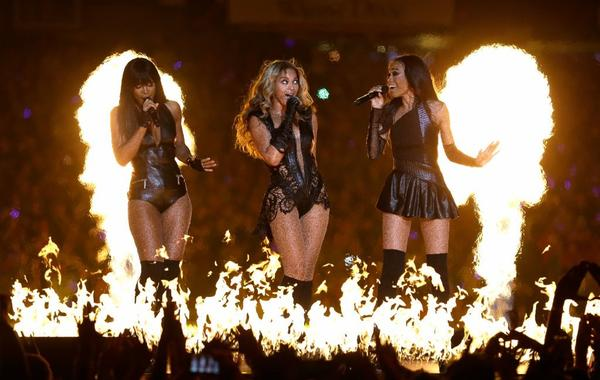 From left, Kelly Rowland, Beyonce and Michelle Williams perform during the Super Bowl XLVII halftime show Sunday, clad in leather and lace.