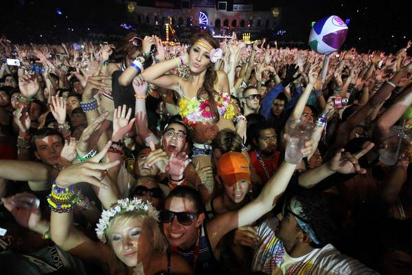 Rave fans dance during an Electric Daisy Carnival event at Exposition Park and the L.A. Memorial Coliseum.