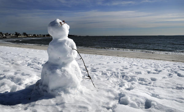 The winter of 2011 was so severe that there was even snow on the beach at Rocky Neck State Park. A walk along the cold, windy beach on revealed a snowman looking out at Long Island Sound dreaming of the day when the beach will be covered with swimmers in bathing suits lying on blankets in the hot sun.