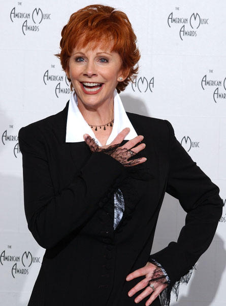 "Country musician and actress <a class=""taxInlineTagLink"" id=""PECLB003178"" title=""Reba McEntire"" href=""/topic/entertainment/music/reba-mcentire-PECLB003178.topic"">Reba McEntire</a> turns 55 today. (Photo by Lucy Nicholson/Getty Images)"